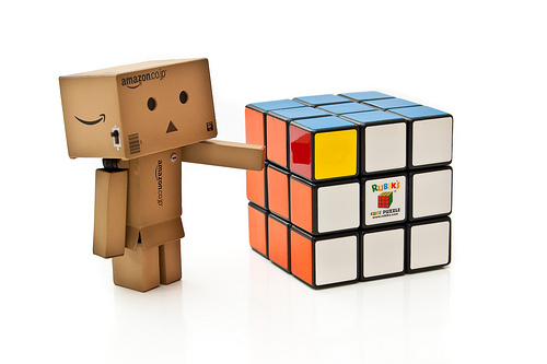Picture of Box-Person Figuring out a Rubik Cube