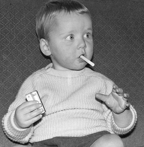 Picture of a kid smoking a cigarette