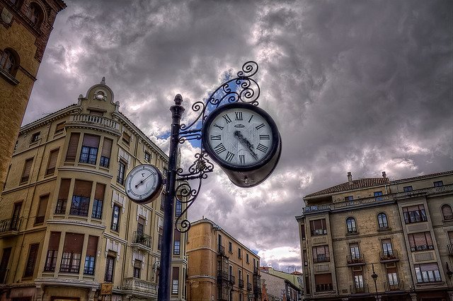 Clock against stormy sky picture