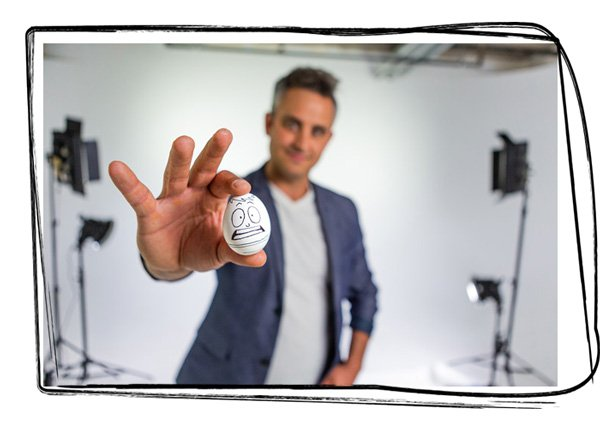 Paul Angone holding-an-egg-with-box